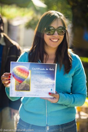 Mariel Merino showing a hot air balloon flying certificate